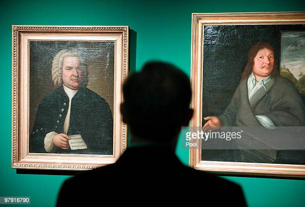 German President Horst Koehler looks at portraits of Johann Sebastian Bach and his father Johann Ambrosius at the Bach Archive on March 21 2010 in...