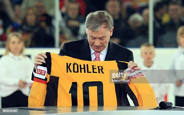 German President Horst Koehler opens the IIHF World Championship group D match between USA and Germany at Veltins Arena on May 7 2010 in...