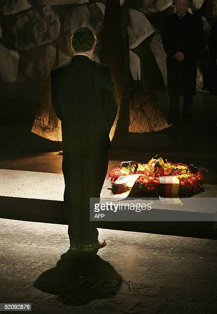 German President Horst Koehler pays his respects after laying a wreath at Jerusalem's Yad Vashem Holocaust memorial 01 February 2005 on the first day...