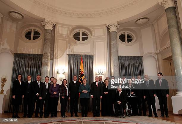 German President Horst Koehler poses with Chancellor Angela Merkel as well as members of the German government cabinet before a dinner at Schloss...