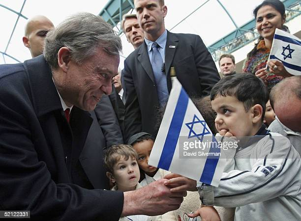 German President Horst Koehler receives an Israeli flag in greeting from a young Jewish boy as he talks with the kindergarten children on February 2...