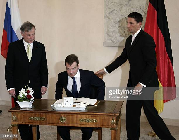 German President Horst Koehler stands beside Russian President Dmitry Medvedev as he signs the guestbook at Bellevue Palace on June 5 2008 in Berlin...