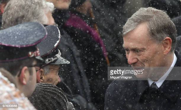 German President Horst Koehler talks to an fire fighter during a commemoration ceremony in front of the Albertville School on March 11 2010 in...