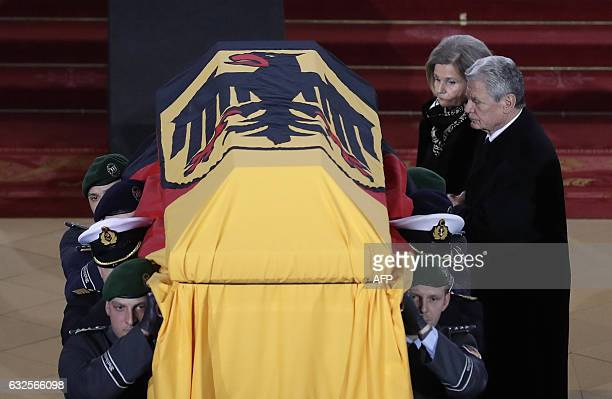 German President Joachim Gauck and Alexandra Freifrau von Berlichingen widow of former German President Roman Herzog follow the coffin after the...