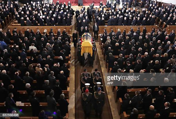 German President Joachim Gauck and Alexandra Freifrau von Berlichingen widow of Roman Herzog follow soldiers carrying the coffin during the state...