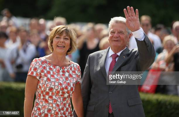 German President Joachim Gauck and First Lady Daniela Schadt greet visitors at the annual Citizens' Fest at Bellevue Palace on August 31, 2013 in...