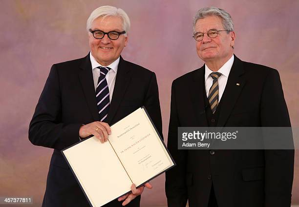 German President Joachim Gauck and Foreign Minister Frank-Walter Steinmeier attend a ceremony in which Gauck appointed the new German government...