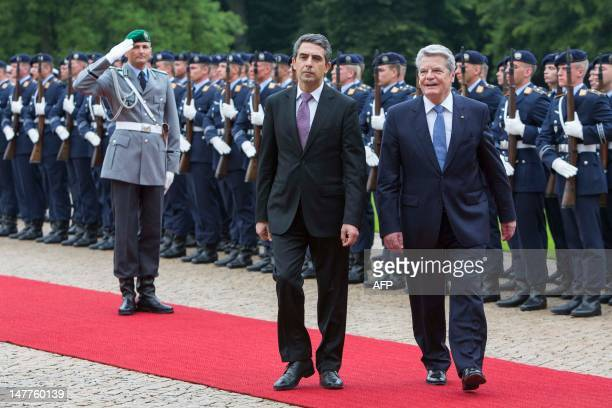 German President Joachim Gauck and his Bulgarian counterpart Rosen Asenov Plevneliev review a guard of honour at the Presidential Palace Bellevue on...