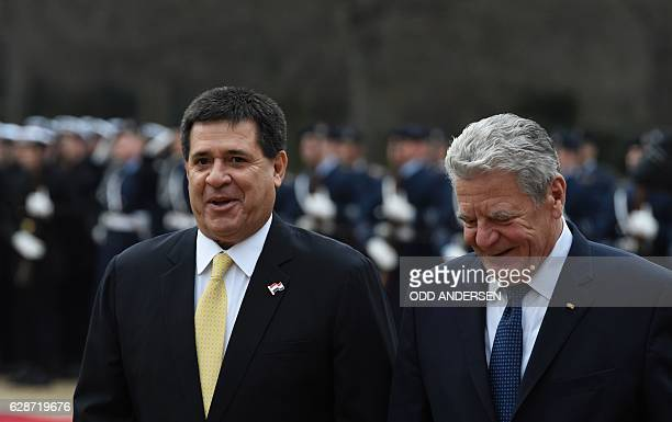 German President Joachim Gauck and his Paraguayan counterpart Horacio Cartes inspect a military honor guard at the presidential Bellevue Palace on...