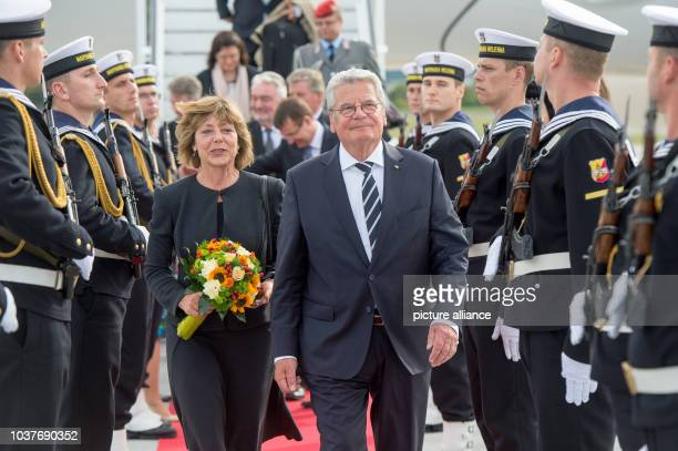 German President Joachim Gauck and his partner Daniela Schadt are welcomed with military honours at the airport in Gdansk Poland 01 September 2014...