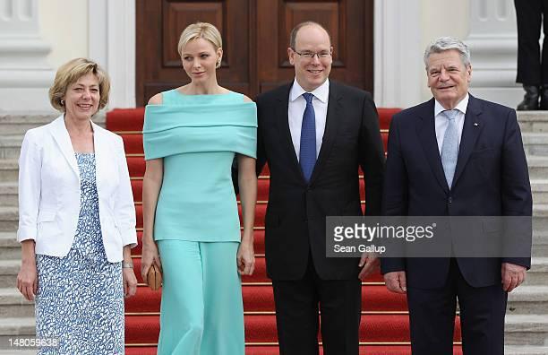 German President Joachim Gauck and his partner Daniela Schadt greet Prince Albert II and Princess Charlene of Monaco at Schloss Bellevue Palace on...