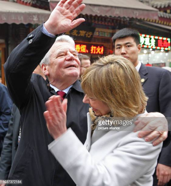 German President Joachim Gauck and his partner Daniela Schadt in the muslim quater of Xi`An China 24 March 2016 The German President is on a fiveday...