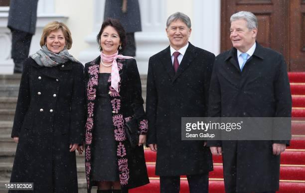 German President Joachim Gauck and his partner Daniela Schadt welcome Kyrgyz President Almaz Atambayev and his wife Raisa Atambayeva at Schloss...