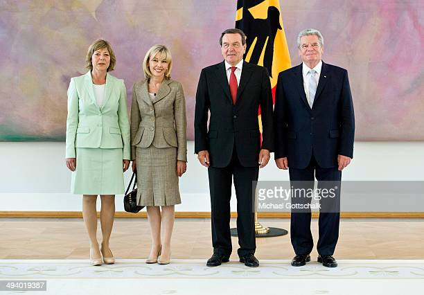 German President Joachim Gauck and his partner Daniela Schadt welcome former German chancellor Gerhard Schroeder and his wife Doris SchroederKoepf...