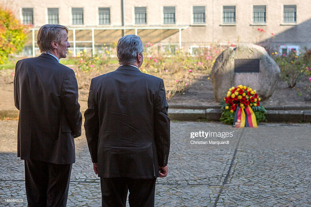 German President Joachim Gauck and Hubertus Knabe, Director of the Memoral 'Gedenkenstaette Berlin Hohenschoenhausen' visit the exhibition on October 22, 2013 in Berlin, Germany. 'Hohenschoenhausen' was the remand prison for people detained by the former East German Ministry for State Security (MfS) or 'Stasi' and has been a Memoral since 1994.