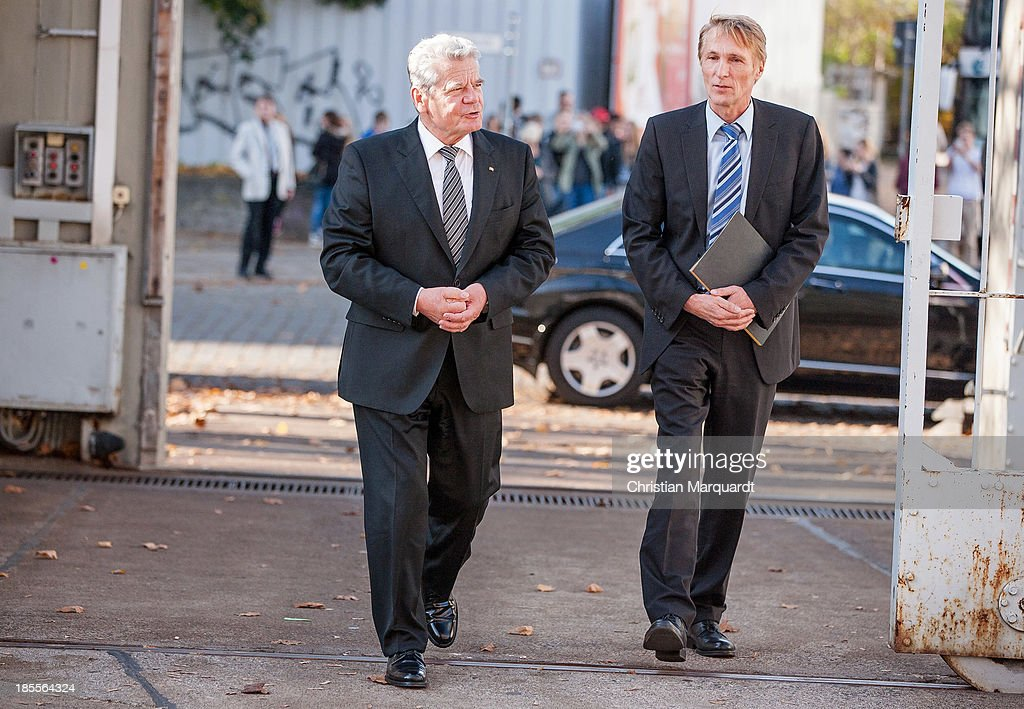 German President Joachim Gauck and Hubertus Knabe, Director of the Memoral 'Gedenkenstaette Berlin Hohenschoenhausen' enter the Memoral on October 22, 2013 in Berlin, Germany. 'Hohenschoenhausen' was the remand prison for people detained by the former East German Ministry for State Security (MfS) or 'Stasi' and has been a Memoral since 1994.