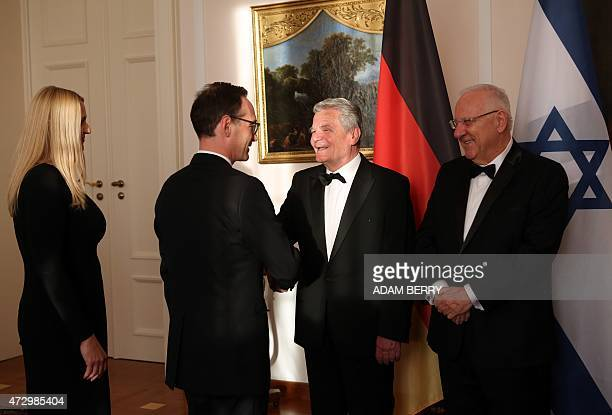 German President Joachim Gauck and Israeli President Reuven Rivlin greet German Justice Minister Heiko Maas and his wife Corinna Maas during a...
