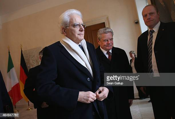 German President Joachim Gauck and Italian President Sergio Mattarella prepare to review a guard of honour upon Mattarella's arrival at Schloss...