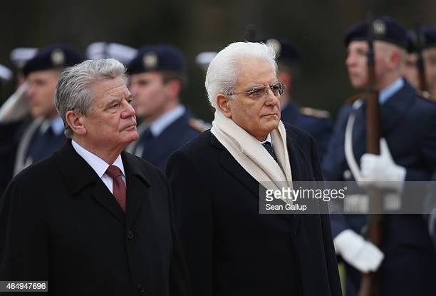 German President Joachim Gauck and Italian President Sergio Mattarella review a guard of honour upon Mattarella's arrival at Schloss Bellevue palace...