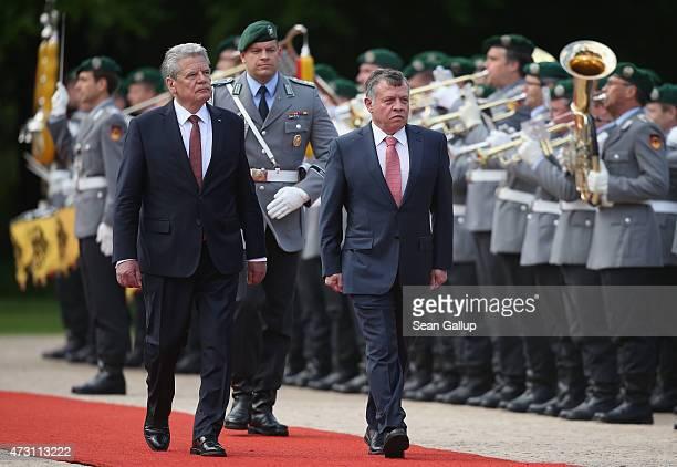 German President Joachim Gauck and King Abdullah II of Jordan review a guard of honour upon King Abdullah's arrival at Schloss Bellevue Palace on May...
