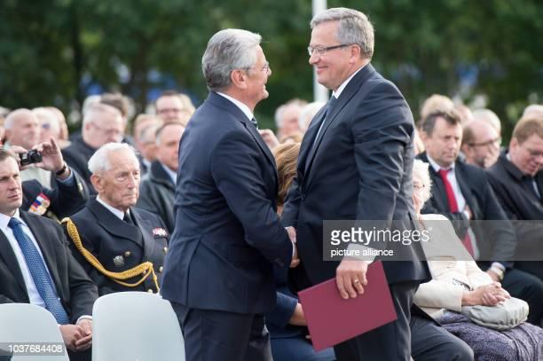 German President Joachim Gauck and Polish President Bronisaw Komorowski shake hands during a commemoration of the start of World War II 75 years ago...
