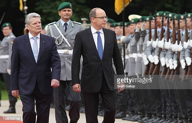 German President Joachim Gauck and Prince Albert II of Monaco review a gaurd of honour at Schloss Bellevue Palace on July 9 2012 in Berlin Germany...