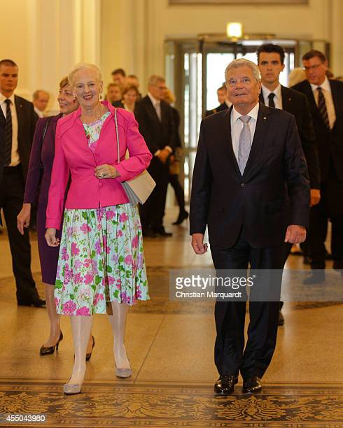 German President Joachim Gauck and Queen Margrethe II of Denmark arrive at MartinGropiusBau on September 9 2014 in Berlin Germany