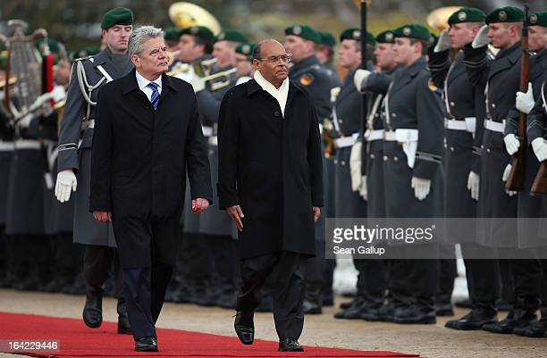 German President Joachim Gauck and Tunisian President Moncef Marzouki review a gaud of honour upon Marzouki's arrival at Bellevue Palace on March 21,...