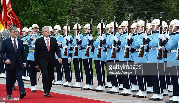 German President Joachim Gauck and Turkish President Abdullah Gul walk past an honor guard during an official welcoming ceremony at the Cankaya...