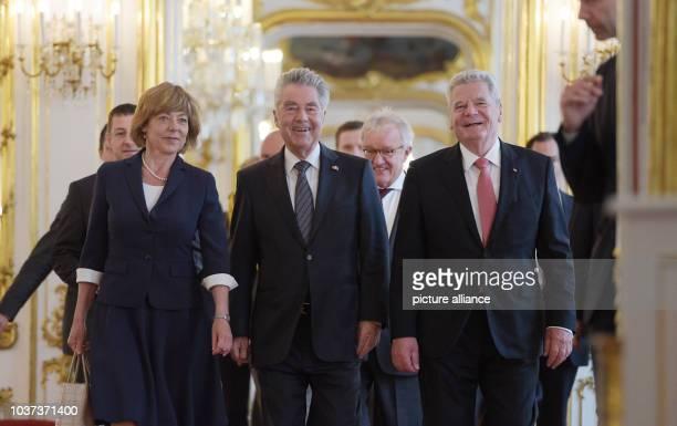 German President Joachim Gauck Austrian President Heinz Fischer and Daniela Schadt life partner of the German president walk through the Marie...