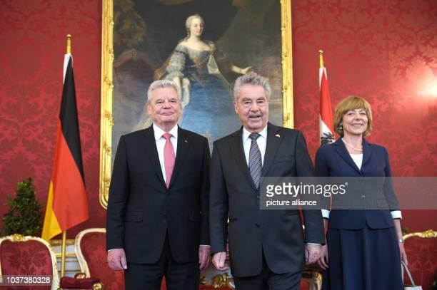 German President Joachim Gauck Austrian President Heinz Fischer and Daniela Schadt life partner of the German president pose for photographs as they...