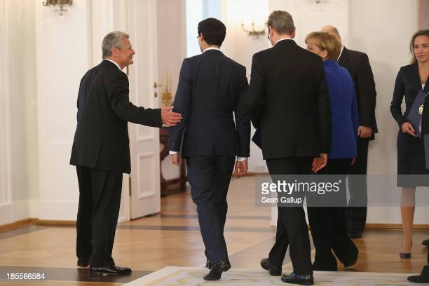 German President Joachim Gauck bids farewell to the ministers and chancellor of the outgoing German government after giving them their dismissal...
