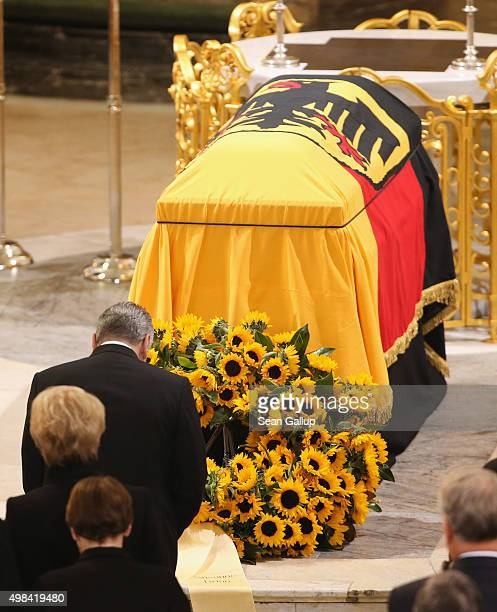 German President Joachim Gauck bows at the coffin of former German Chancellor Helmut Schmidt prior to the funeral service at Sankt Michaelis church...