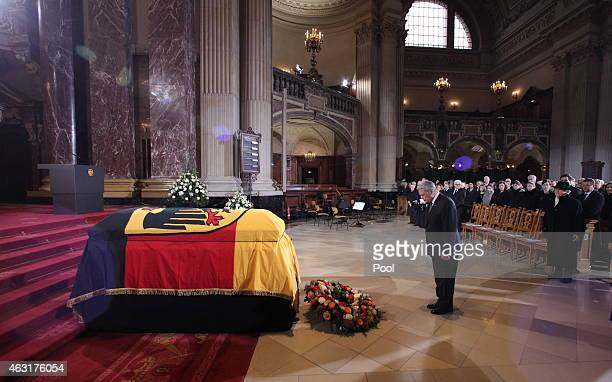 German President Joachim Gauck bows while the widow Marianne von Weizsaecker stands behind him during the funeral ceremony for the late former German...