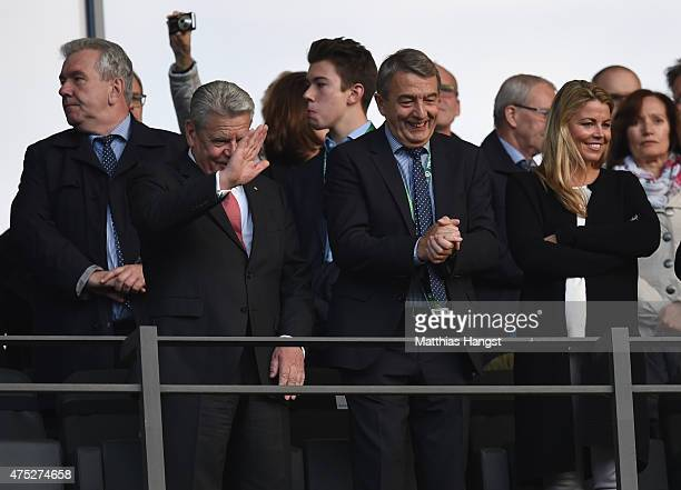 German President Joachim Gauck DFB President Wolfgang Niersbach and his partner Marion Popp enjoy the atmosphere ahead of the DFB Cup Final match...