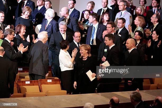 German President Joachim Gauck, French President Francois Hollande and German Chancellor Angela Merkel arrive for a concert at the Berliner...