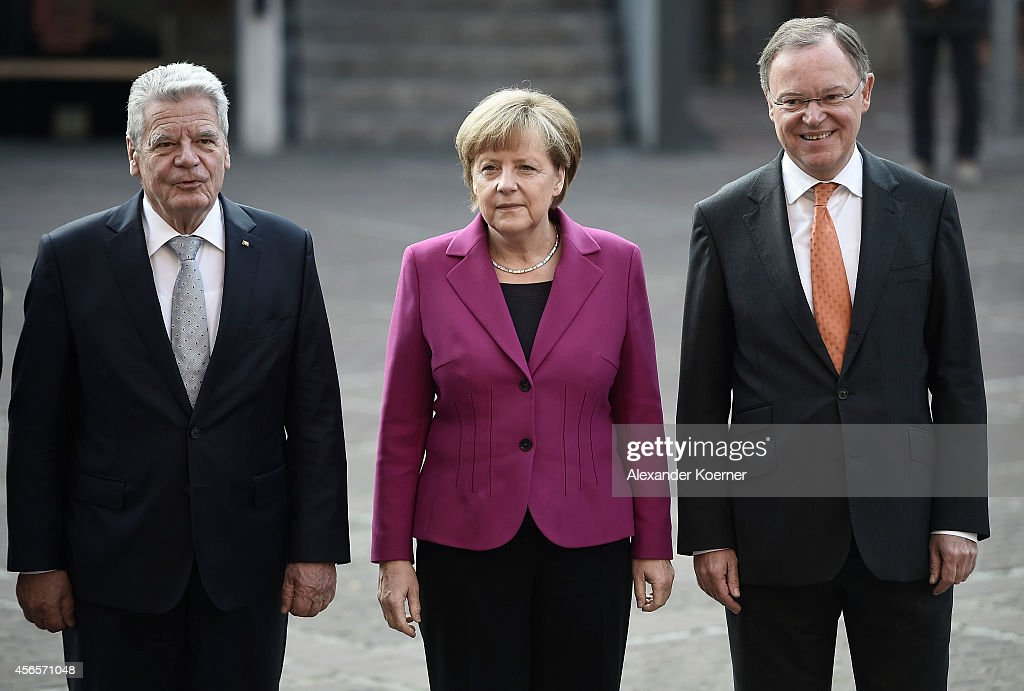 German President Joachim Gauck, German Chancellor Angela Merkel and Prime Minister of the State of Lower Saxony Stephan Weil are pictured during the celebrations of the German Unification Day on October 3, 2014 in Hanover, Germany. German Unification Day commemorates the anniversary of German reunification 1990 after West Germany and East Germany reunited following the end of the Cold War.