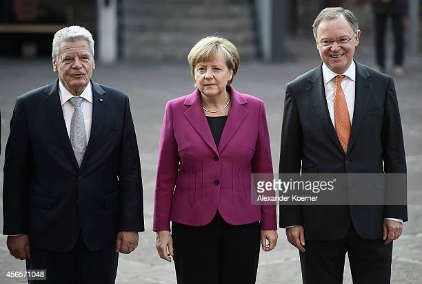 German President Joachim Gauck, German Chancellor Angela Merkel and Prime Minister of the State of Lower Saxony Stephan Weil are pictured during the...