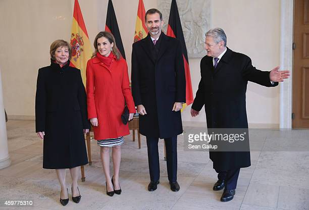 German President Joachim Gauck gestures after King Felipe VI and Queen Letizia of Spain signed the official guest book as German First Lady Daniela...