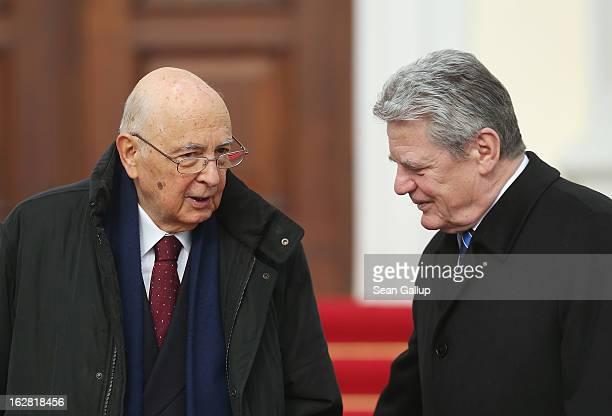 German President Joachim Gauck greets Italian President Giorgio Napolitano upon Napolitano's arrival at Schloss Bellevue palace on February 28, 2013...