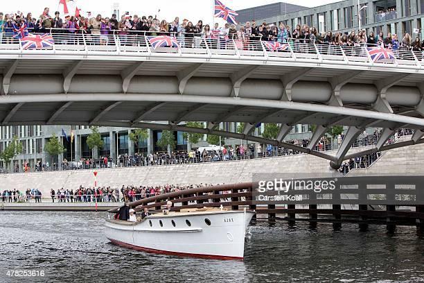 German President Joachim Gauck, his partner Daniela Schadt, Queen Elizabeth II and Prince Philip, the Duke of Edinburgh, ride a boat on the Spree...