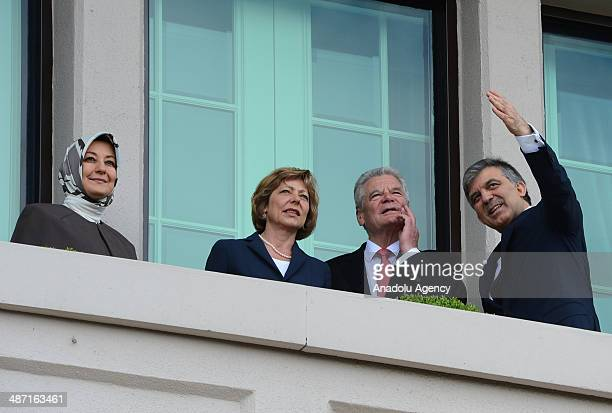 German President Joachim Gauck , his partner Daniela Schadt , Turkish President Abdullah Gul and his wife Hayrunnisa Gul are seen at the balcony of...