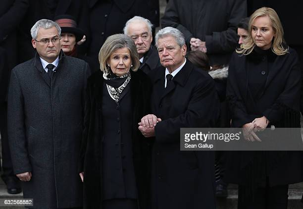 German President Joachim Gauck holds the hand of Baroness Alexandra von Berlichingen widow of former German President Roman Herzog at the conclusion...