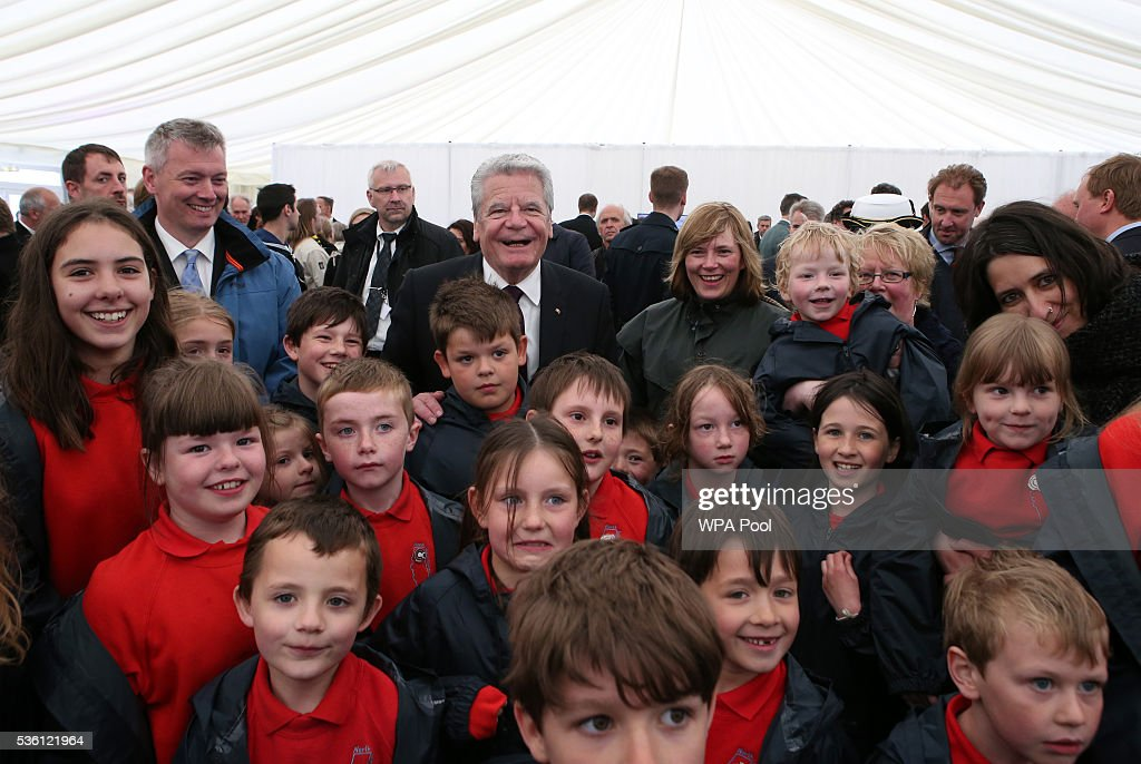 German President Joachim Gauck (C) meets local school children after a service at Lyness Cemetery during the 100th anniversary commemorations for the Battle of Jutland on May 31, 2016 in Hoy, Scotland. The event marks the centenary of the largest naval battle of World War One where more than 6,000 Britons and 2,500 Germans died in the Battle of Jutland fought near the coast of Denmark on 31 May and 1 June 1916.