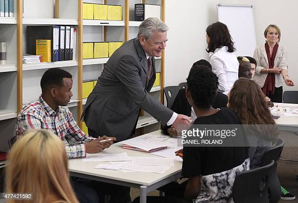 German President Joachim Gauck meets young refugees during his visit at the FriedrichFeld vocational school of commerce in Giessen central Germany on...