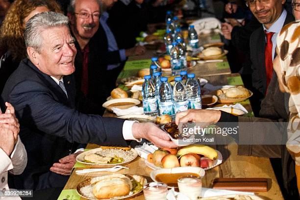 German President Joachim Gauck participates in the iftar meal with Muslims observing Ramadan on June 13 2016 in Berlin Germany Iftar is daily sunset...