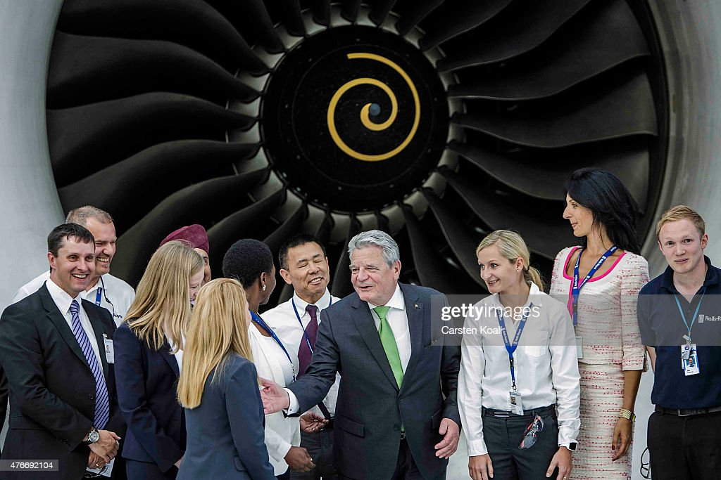 German President Joachim Gauck poses for a group picture together with employees while visiting the Rolls-Royce Mechanical Testing Operations Center on June 11, 2015 near Berlin, Germany. Gauck was visiting the center to learn about its integration of immigrants among its workforce.