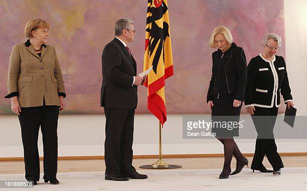 German President Joachim Gauck prepares to hand incoming German Education Minister Johanna Wanka her appointment papers as outgoing Education...