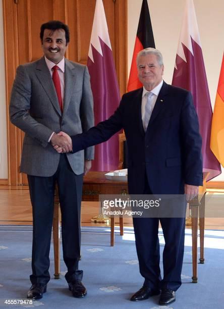 German President Joachim Gauck shake hands with Qatar's emir Sheikh Tamim bin Hamad Al Thani at Bellevue Palace in Berlin Germany on September 17 2014