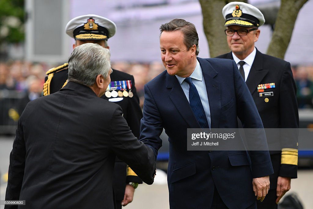 German President Joachim Gauck, shakes hands with British Prime Minister David Cameron as they attend the commemorations of the 100th anniversary of the Battle of Jutland at St Magnus Cathedral on May 31, 2016 in Kirkwall,Scotland. The event marks the centenary of the largest naval battle of World War One where more than 6,000 Britons and 2,500 Germans died in the Battle of Jutland fought near the coast of Denmark on 31 May and 1 June 1916